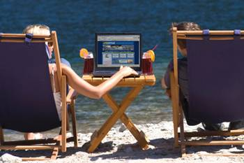 Using a computer on the beach